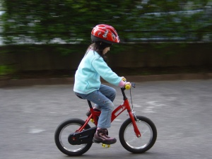 A girl enjoying her bike